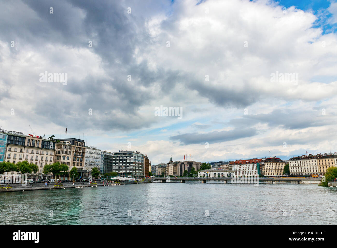 View of the Old Town with the Rhone and the bridge Pont de la Machine under a cloudy sky. Geneva, Switzerland. - Stock Image