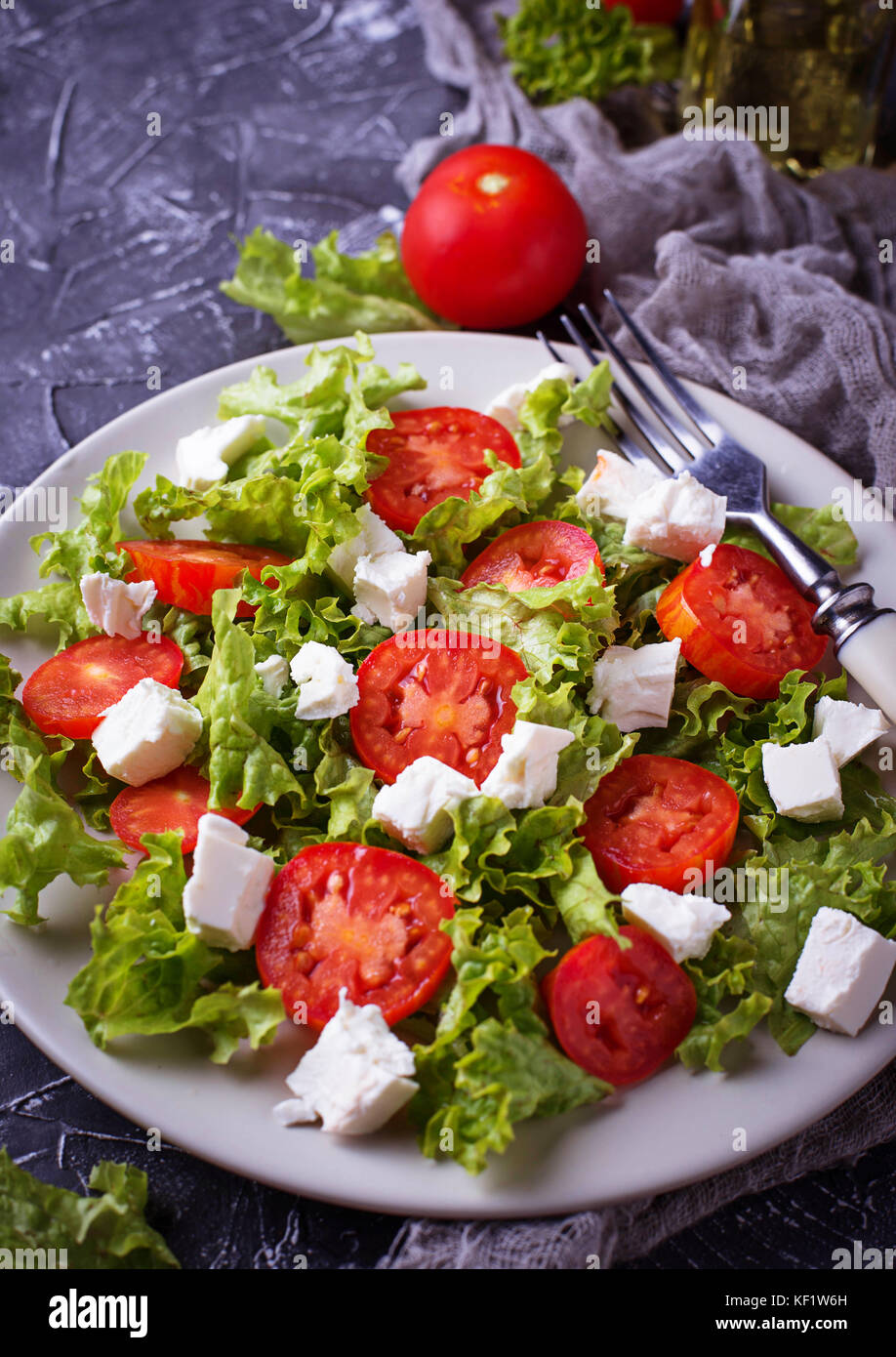 Healthy salad with tomato and feta cheese - Stock Image