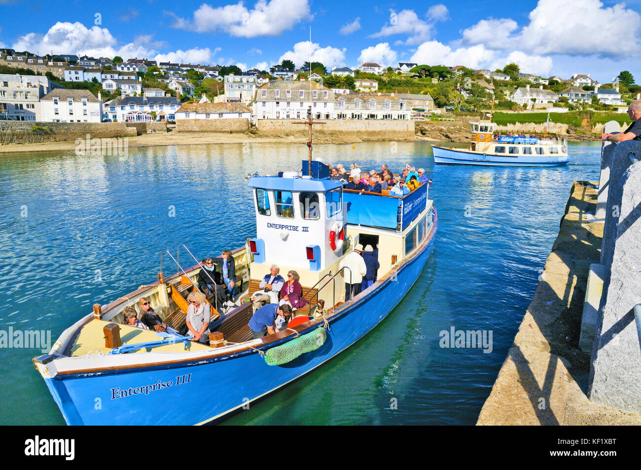 Tourists on a boat trip at St Mawes, Roseland Peninsula, Cornwall, UK - Stock Image