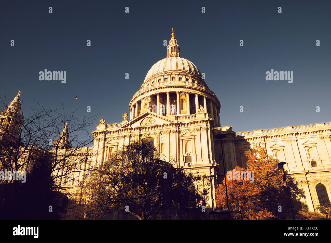 St Paul's Cathedral, London, UK.  Golden sunlight bathes the southern facade of Sir Christopher Wren's masterpiece - Stock Image
