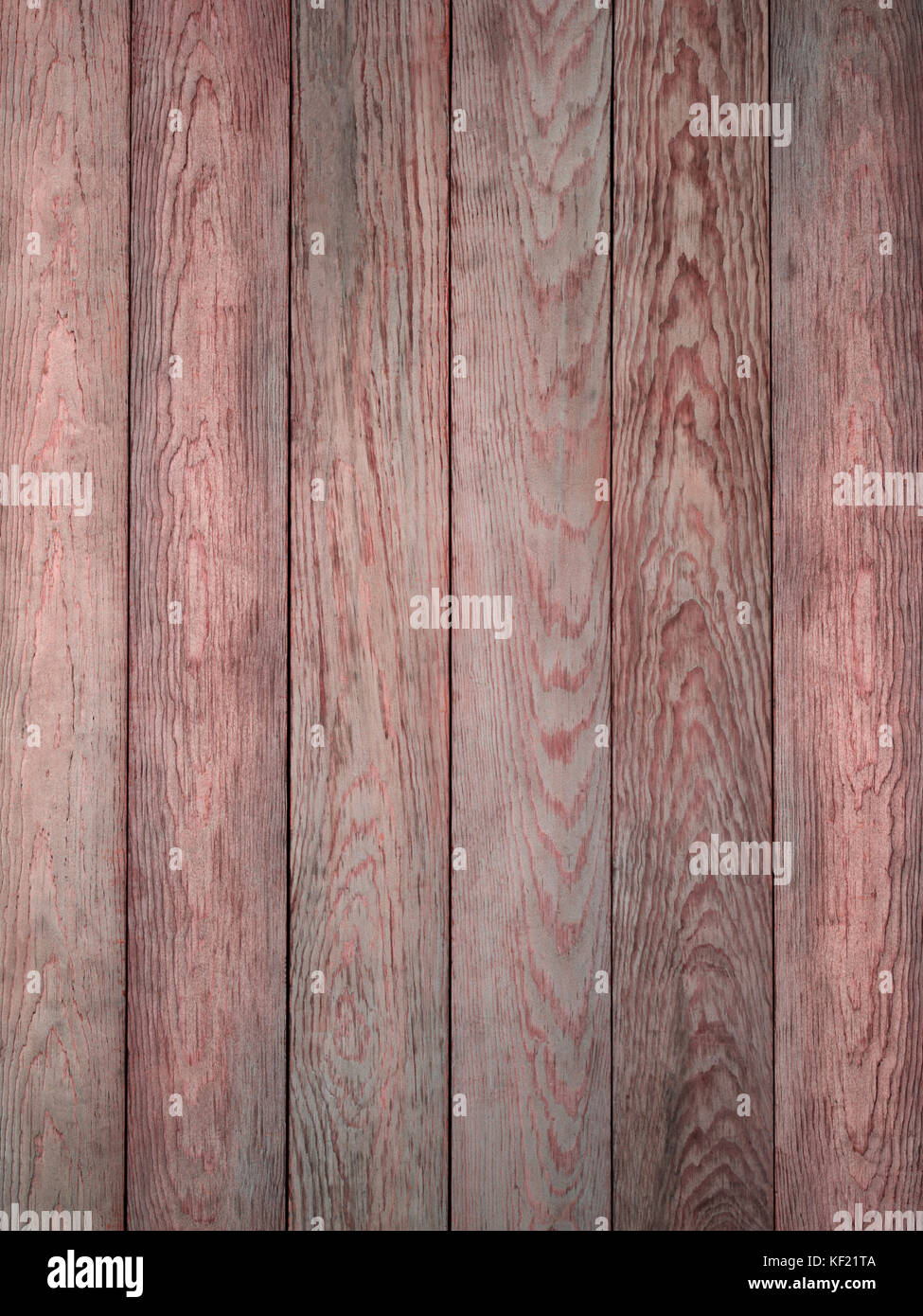 Rustic red gray weathered barn wood board background showing rich grain - Stock Image