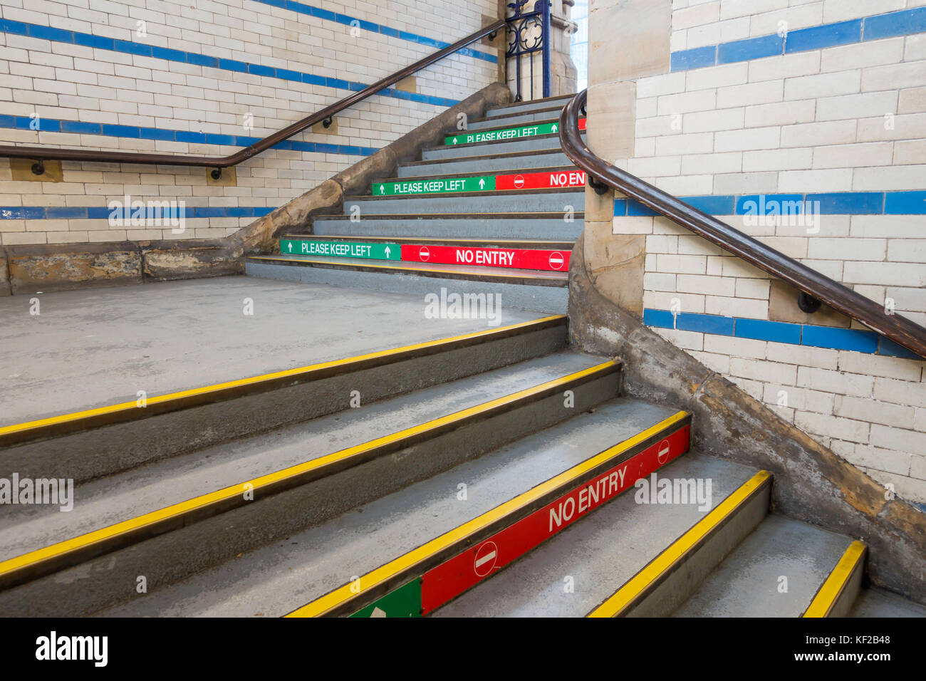 """Railway train station platform access stairs risers marked """"Please keep Left"""" on the left hand side and """"No Entry"""" Stock Photo"""