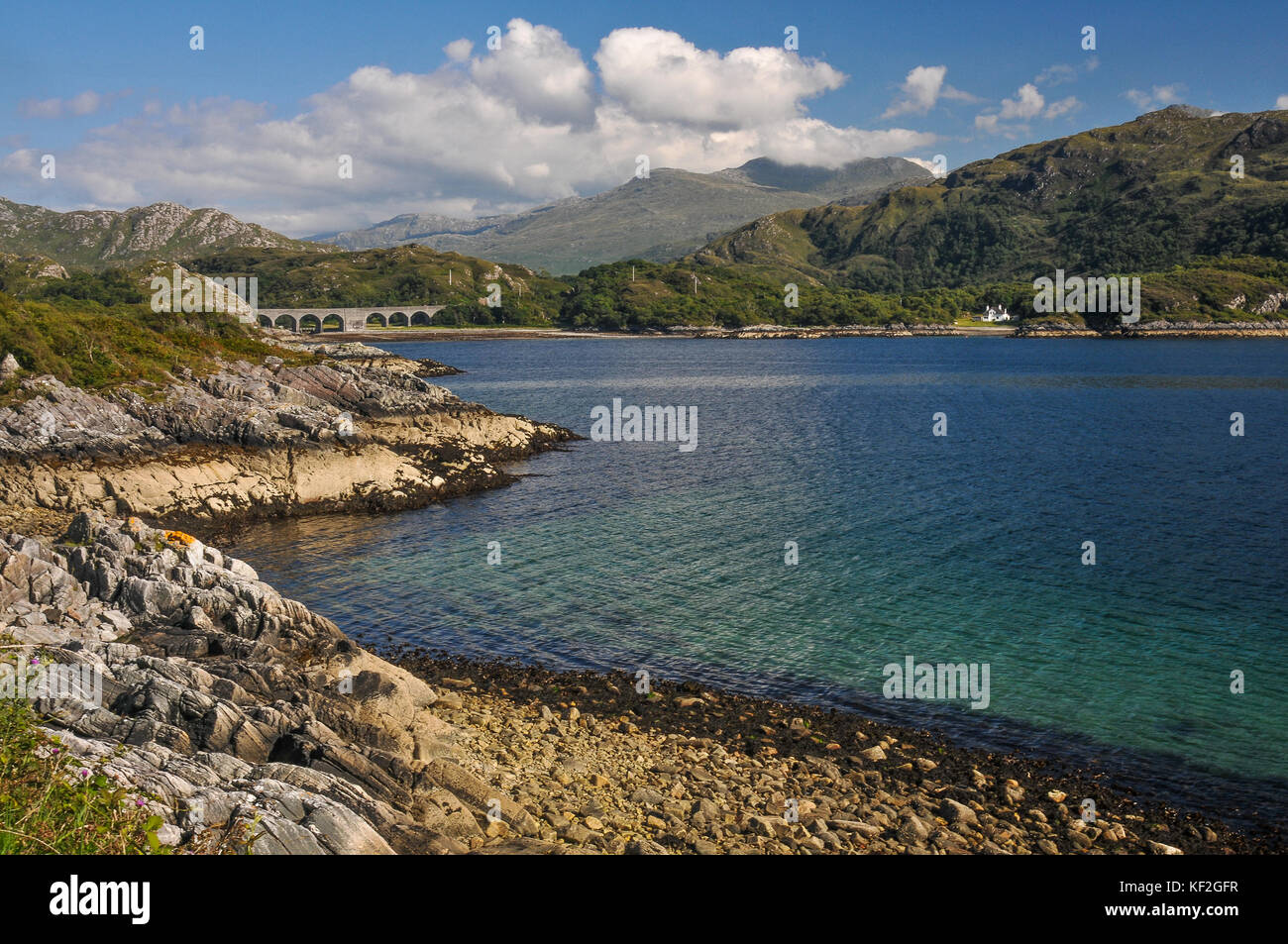 Sunny summer view across the spectacular Loch Nan Umbh on the Road to the Isles on Scotland's west coast with - Stock Image
