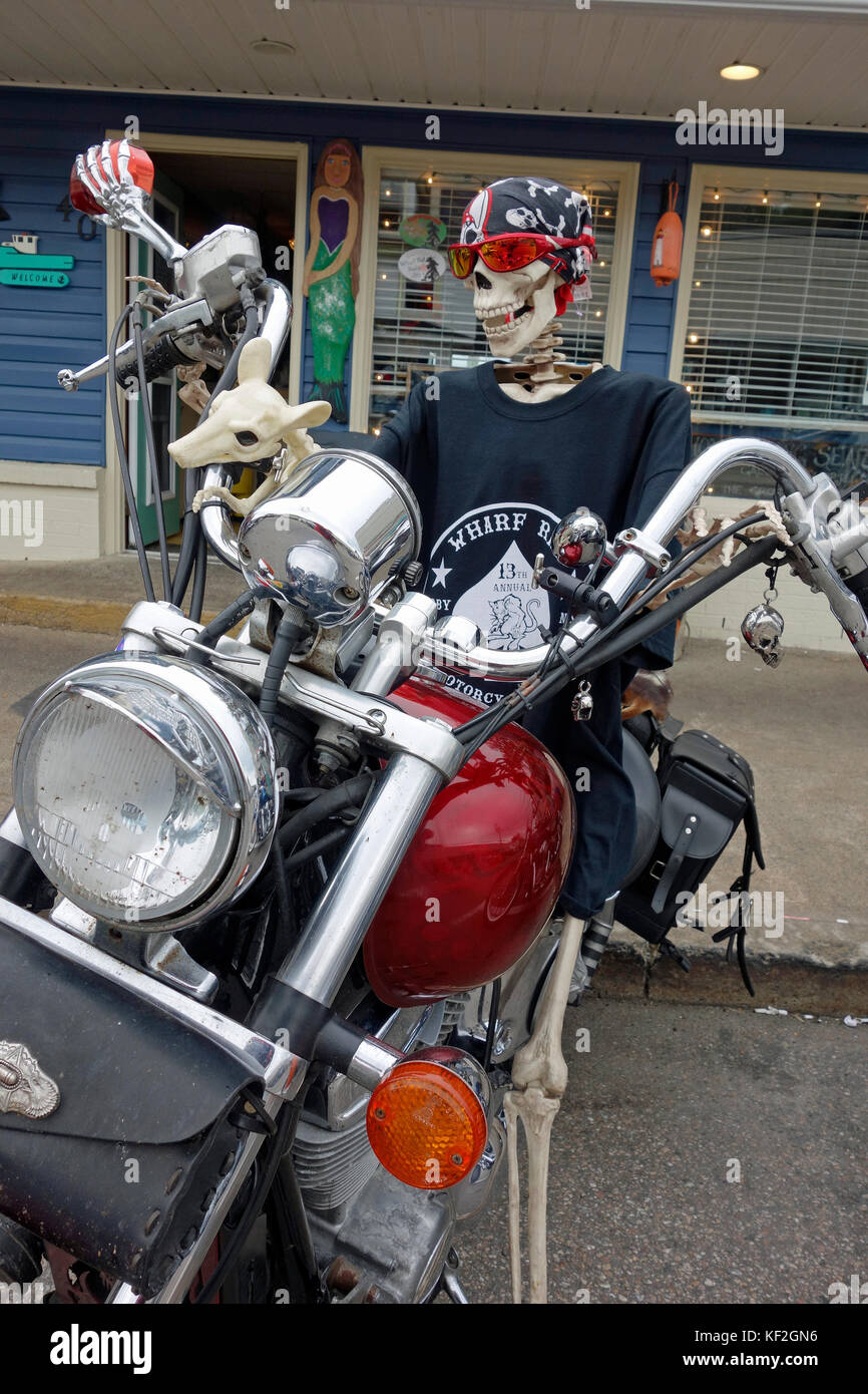 A skeleton rider on a motorcycle at the Wharf Rat Rally in Digby, Nova Scotia - Stock Image