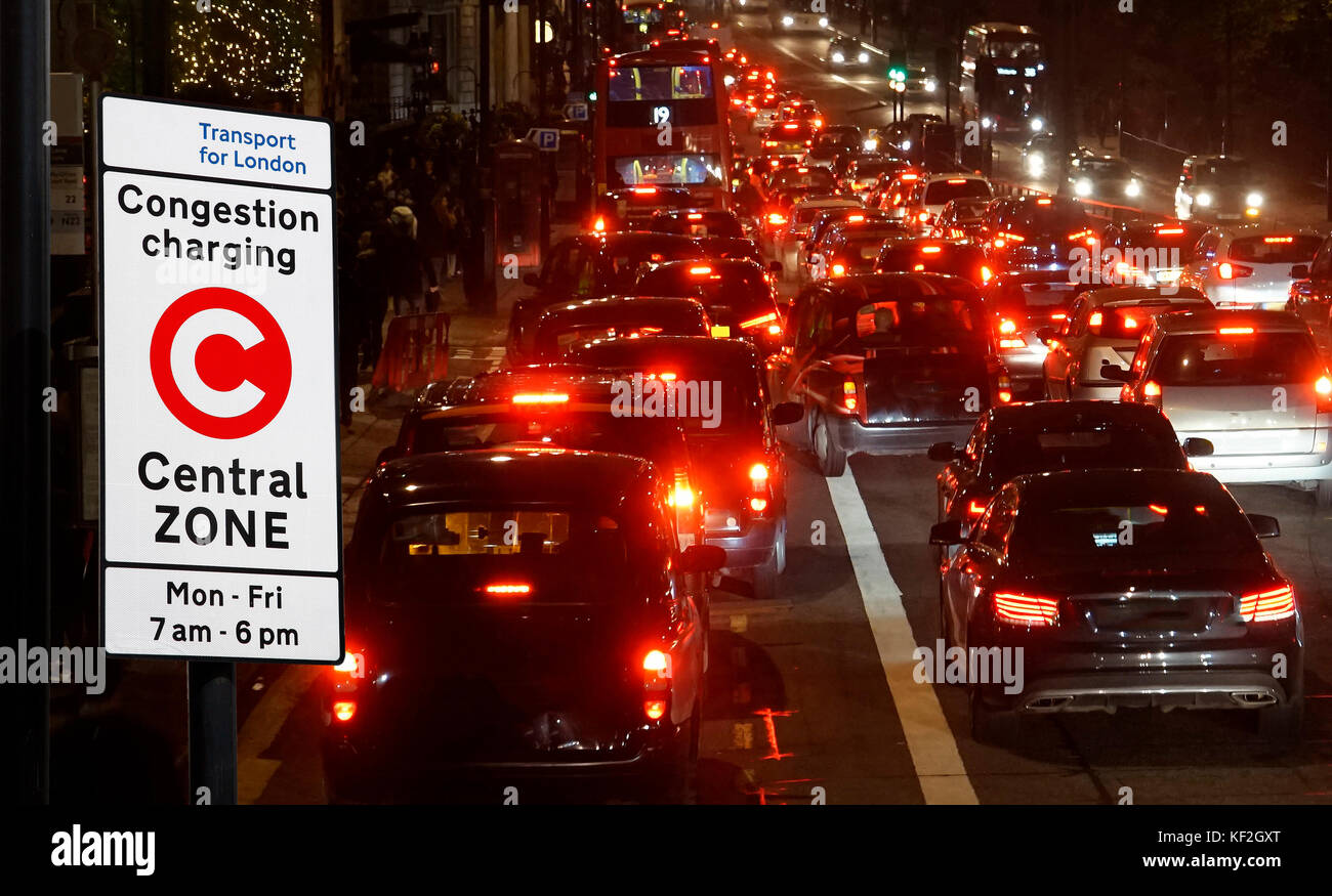 Rush hour on London streets, Evening traffic jam, congestion charging sign post present - Stock Image