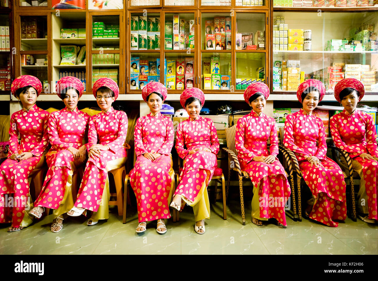 Ho Chi Minh City, Vietnam - January 1, 2009: Group of young Vietnamese women bridesmaids sitting in a pharmacy in - Stock Image