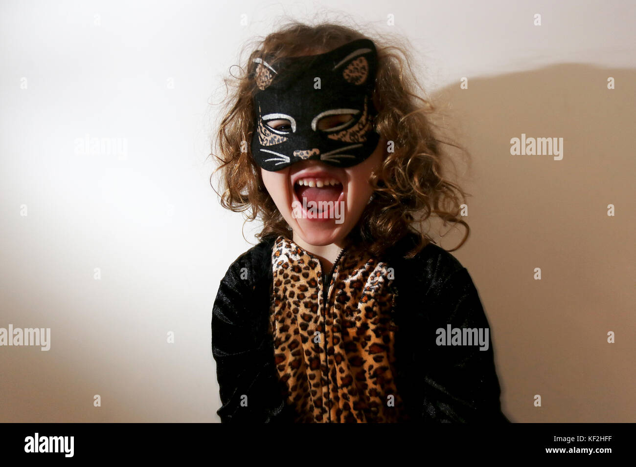 A young 5-year-old girl pictured dressed up as a cat for Halloween fun and celebrations in Chichester, West Sussex, - Stock Image