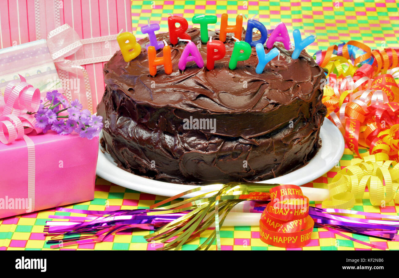 Awe Inspiring A Chocolate Happy Birthday Cake With Happy Birthday Candles On Top Funny Birthday Cards Online Overcheapnameinfo