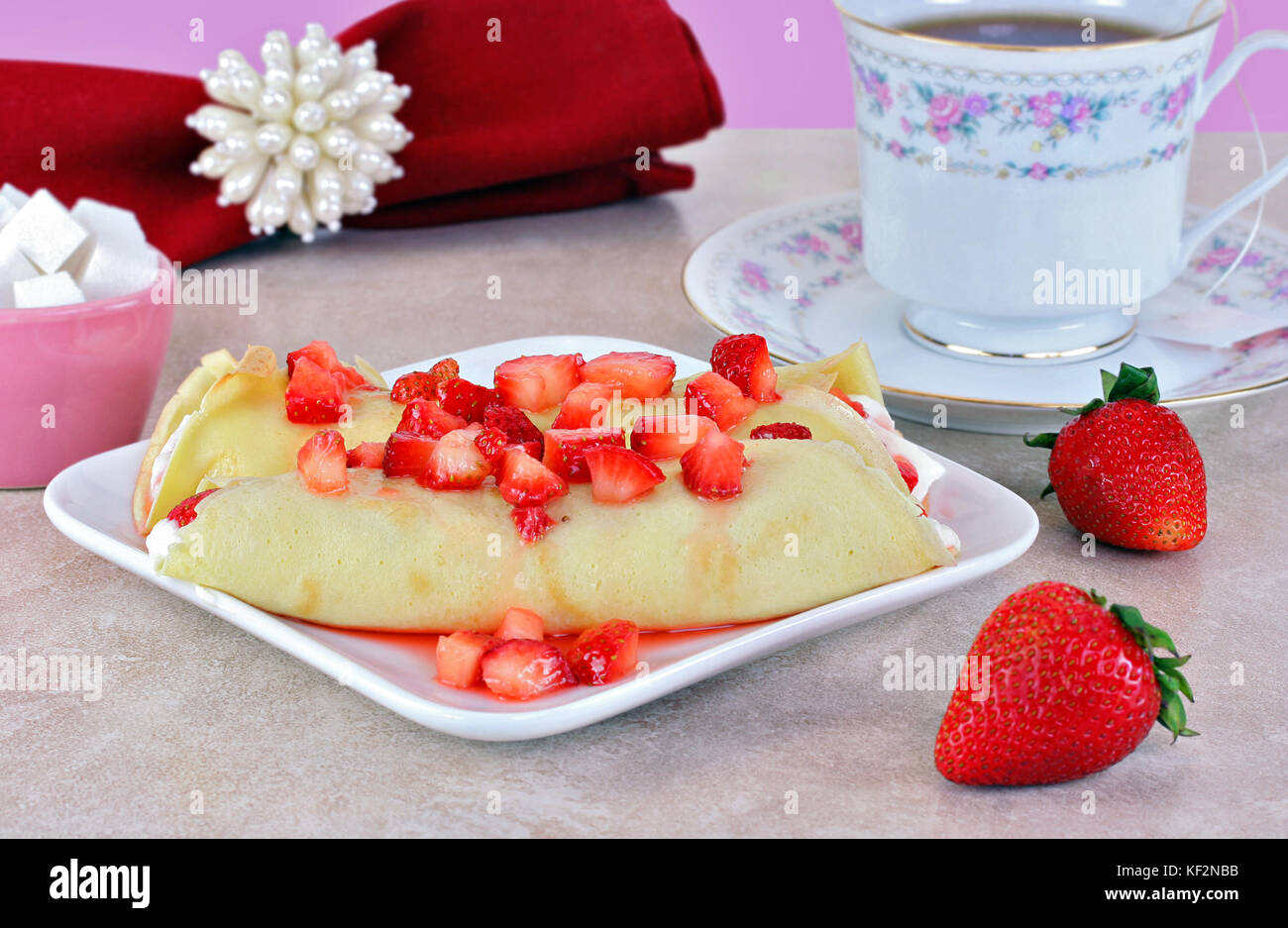 Delicate strawberry crepes set in a feminine table setting Stock ...