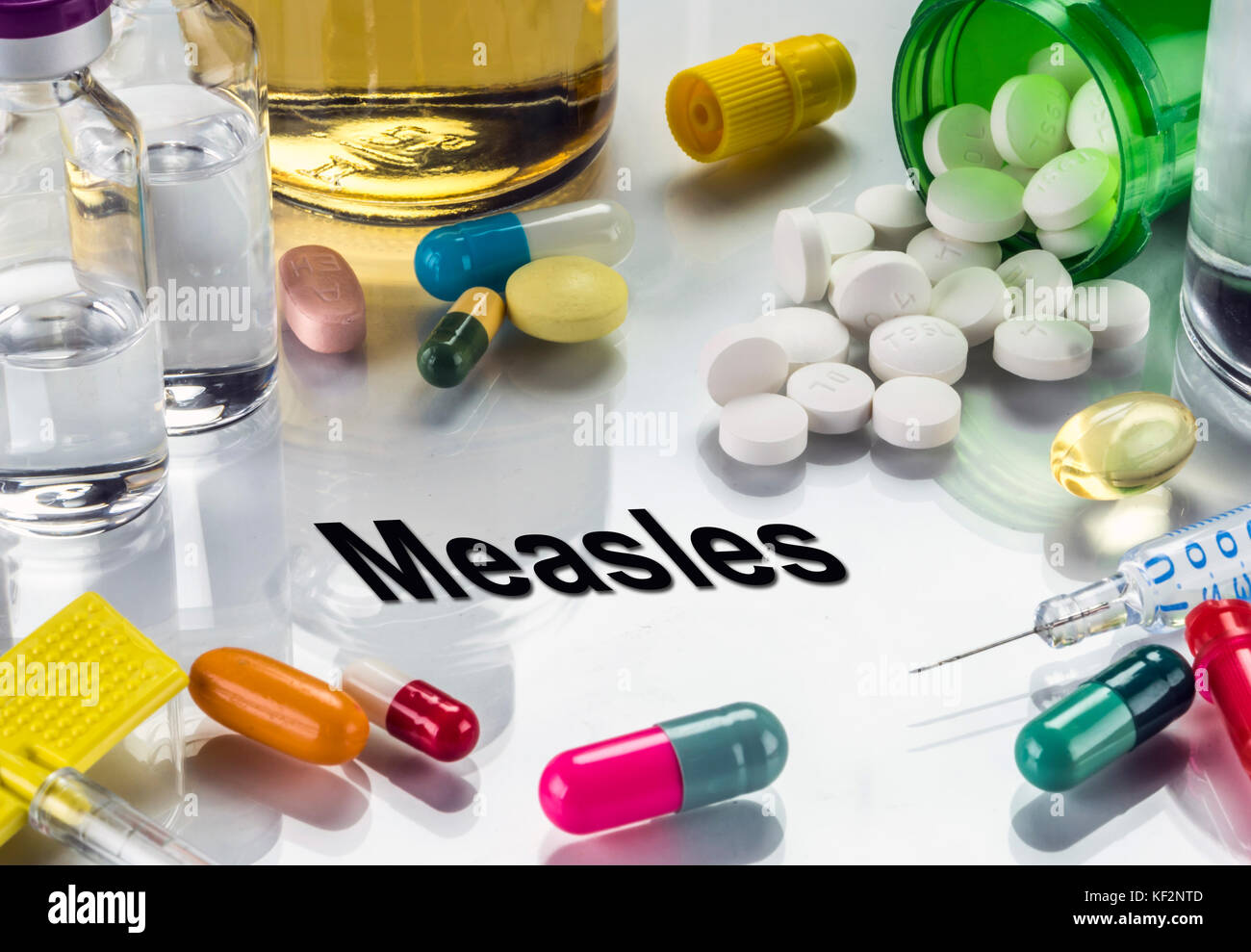 Measles, medicines as concept of ordinary treatment, conceptual image - Stock Image