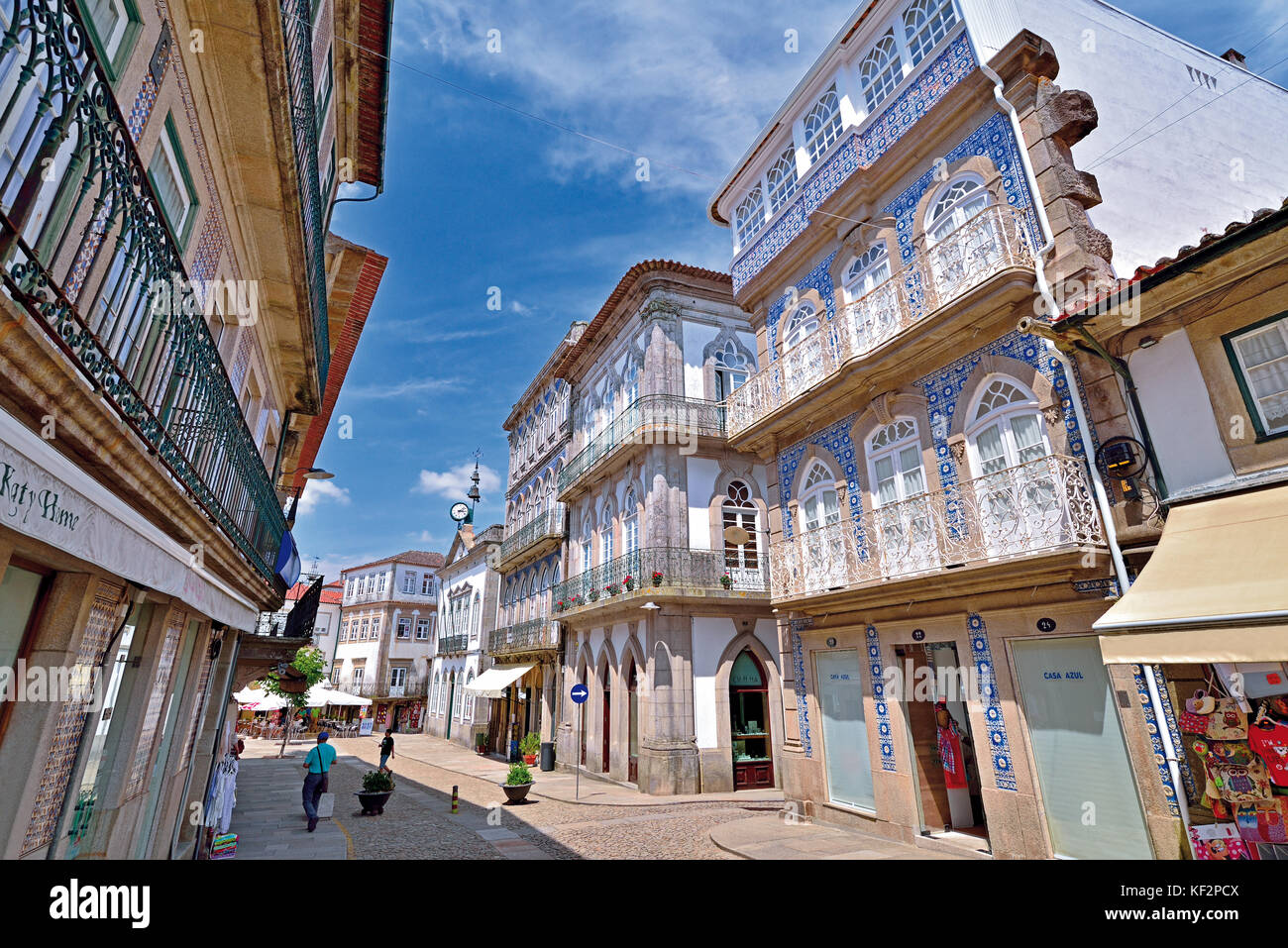 City road with historic buildings covered with blue and white tiles and iron balconies Stock Photo