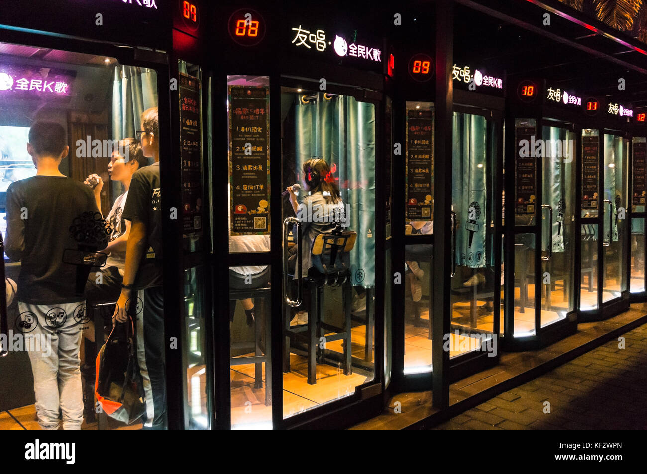 Mini karaoke booths placed in popular and convenient locations in Chinese cities so that people can sing whenever - Stock Image