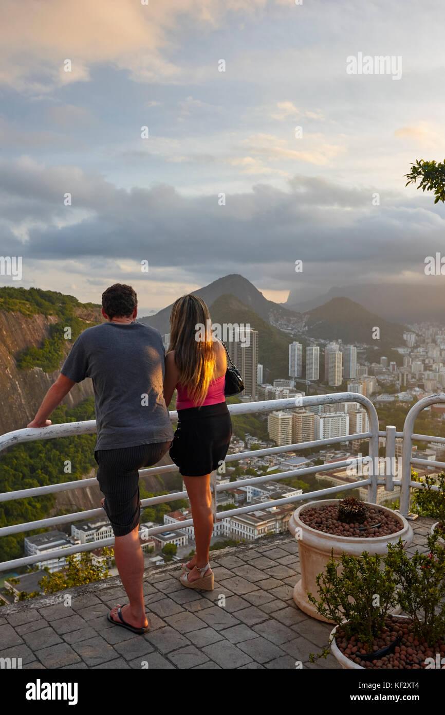 Tourists looking at Botafogo from Sugarloaf Mountain (Pao de Acucar), Rio de Janeiro, Brazil, South America Stock Photo