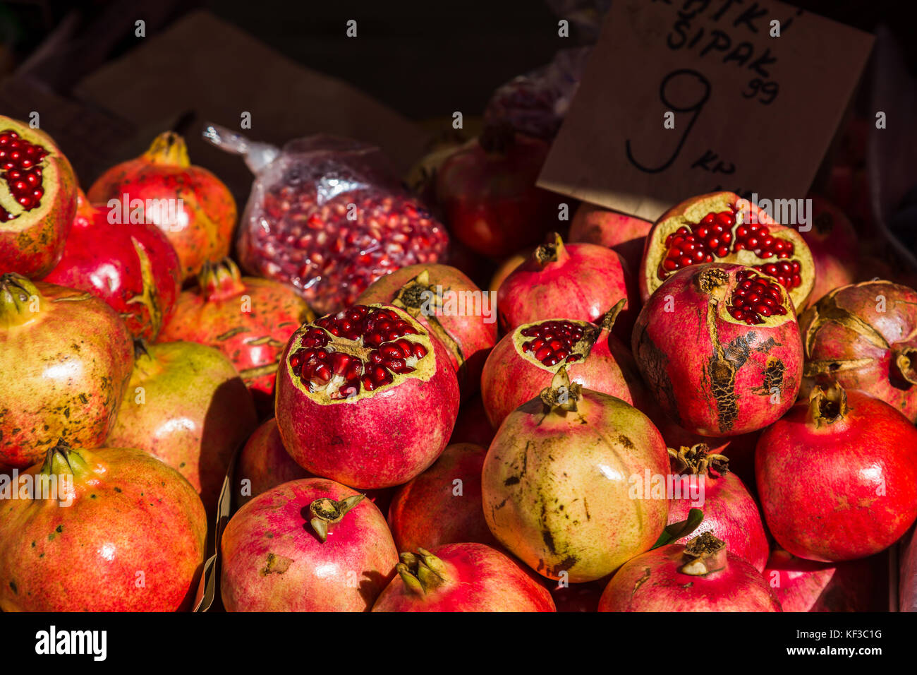 Pomegranate seeds sparkle in the autumn sunshine as they sit piled up on a market stall on Split's green market. - Stock Image