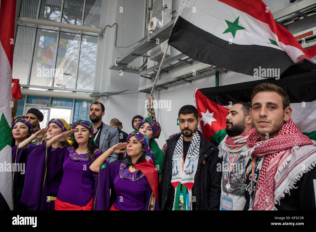 Syrian people wave the national flag at the 2017 World Festival of Youth and Students in the Olympic Park's - Stock Image