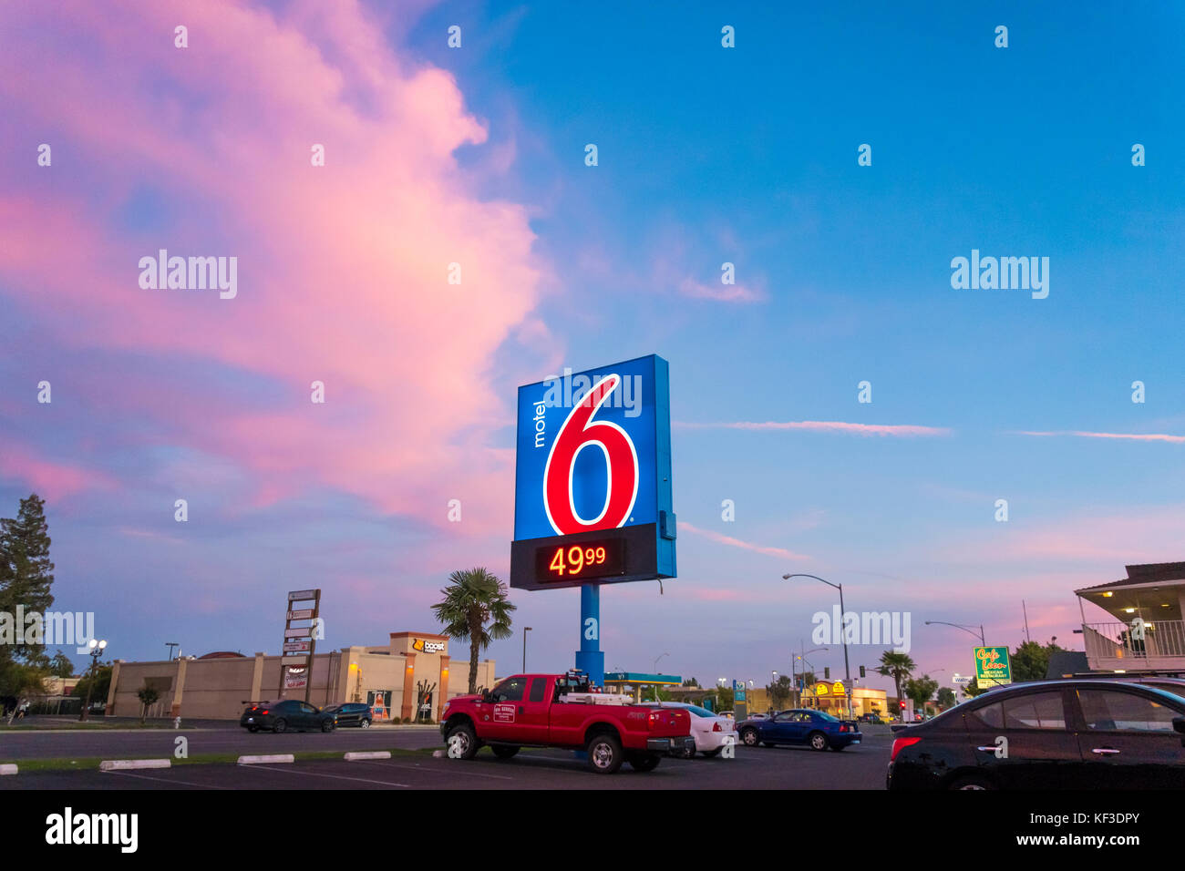 Motel 6 sign with low price of 49.99 in Fresno CA at sunset - Stock Image