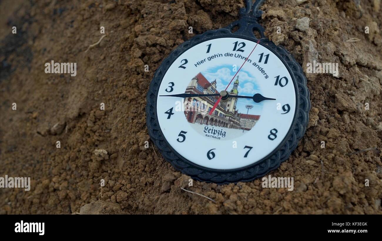 Wall clock wall clocks go back footage wall clock go backwards wall clock wall clocks go back footage wall clock go backwards vintage wall clock lying on the ground ground background gumiabroncs Images