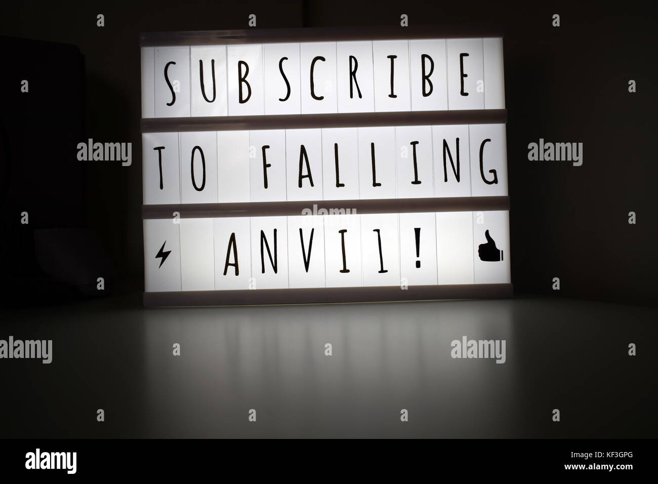Illuminated sign 'subscribe to falling anvil' - Stock Image