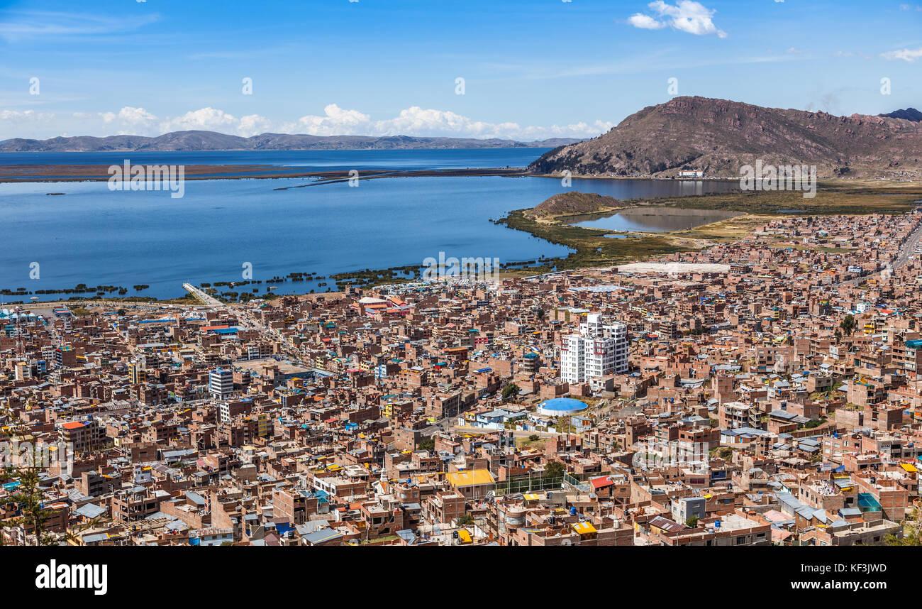 Peruvian city Puno and lake Titicaca panorama, Peru - Stock Image