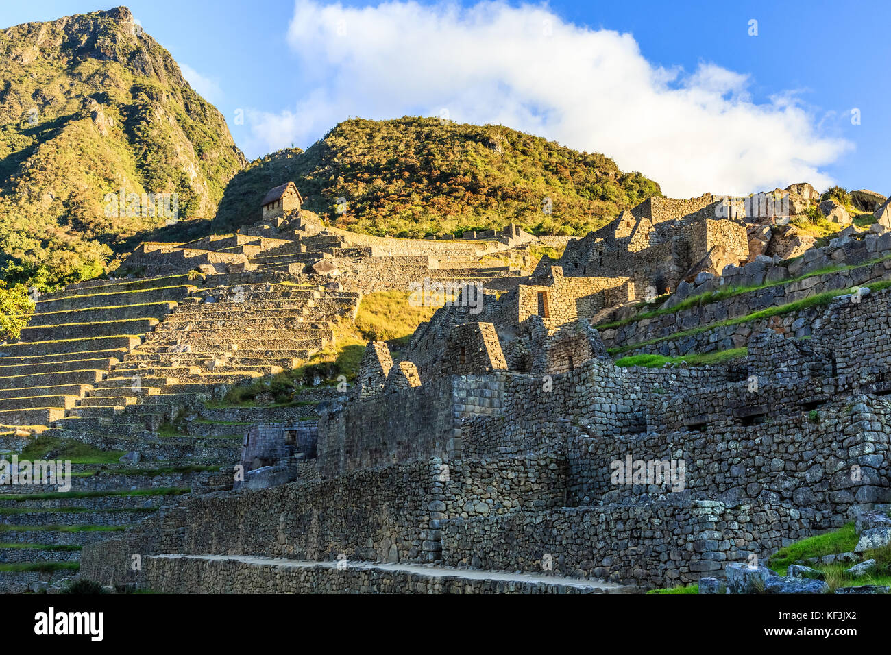 Machu Picchu green terraces and ruins with mountains in the background, Urubamba provnce, Peru Stock Photo