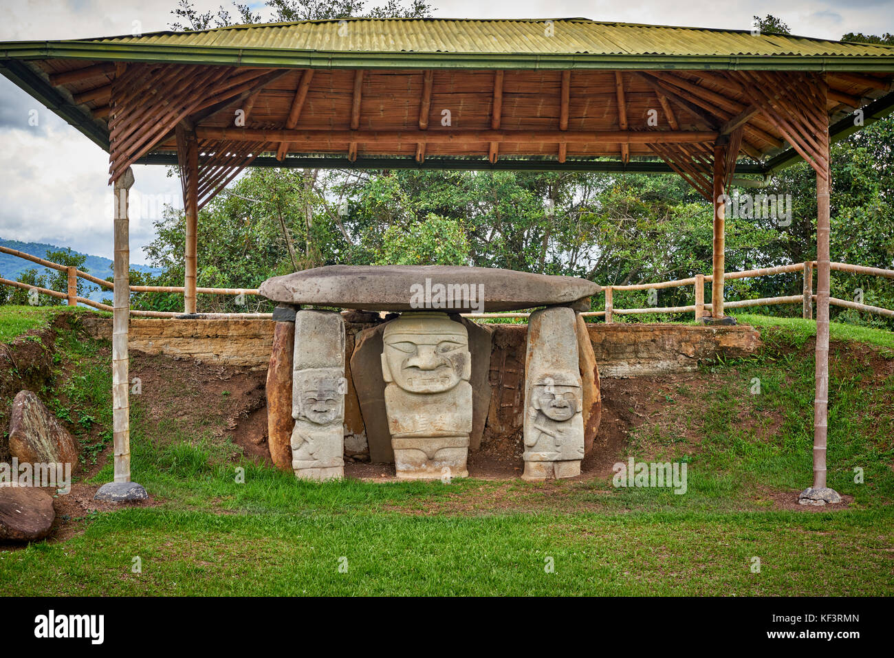 Precolombian statues in front of tombs in Mesita A of archaeological park Parque Arqueologico De San Agustin, Colombia, - Stock Image