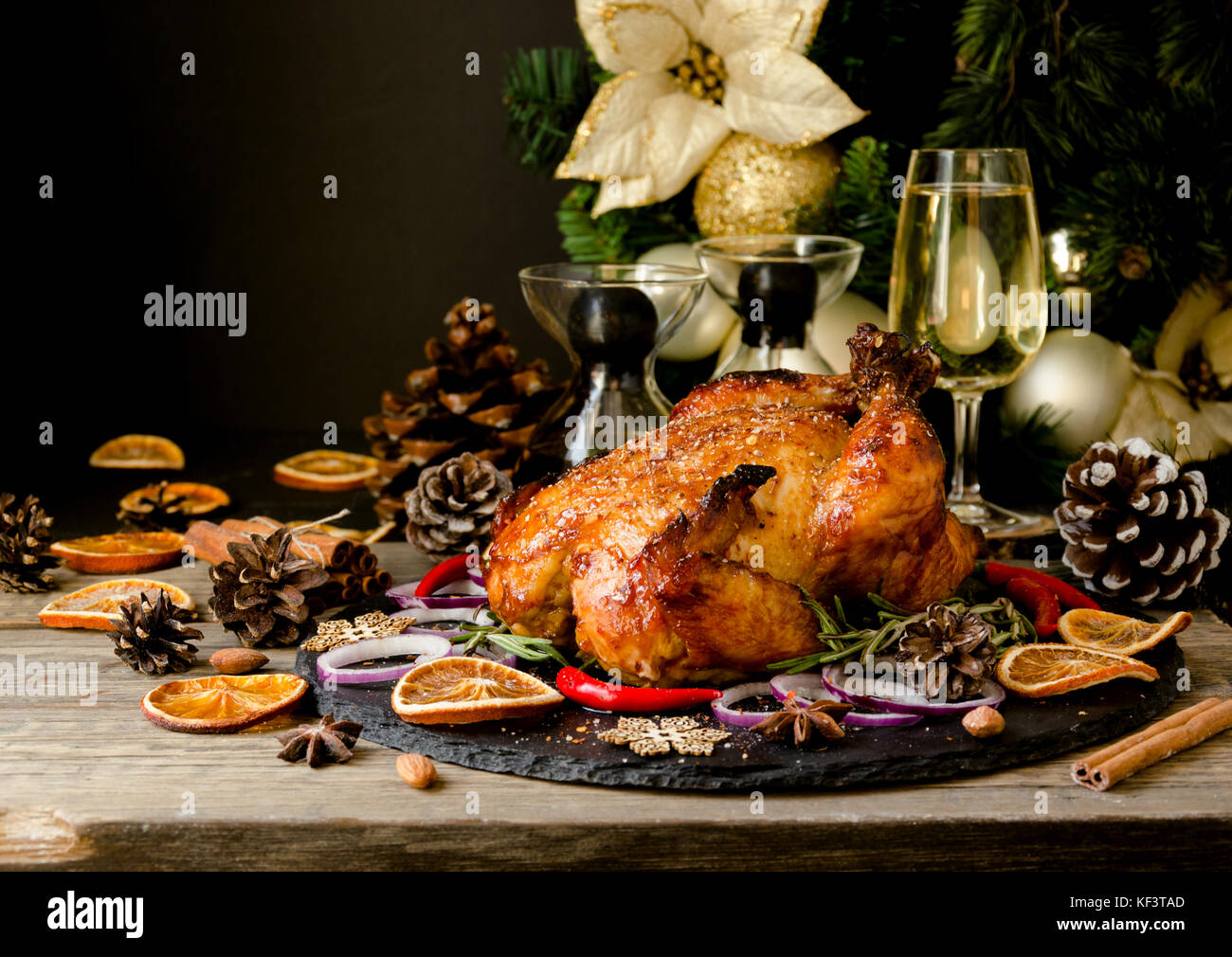 Roast chicken or turkey for Christmas and New Year with mulled wine and Christmas decorations, space for text, selective - Stock Image