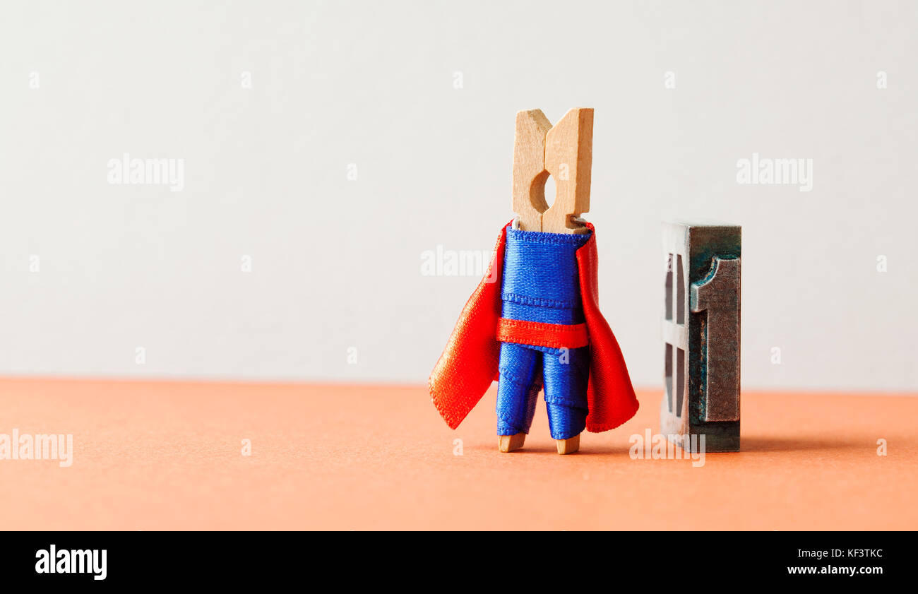 Champion superstar hero won first place. Successful leadership conceptual photography. Brave wooden clothespin superhero - Stock Image