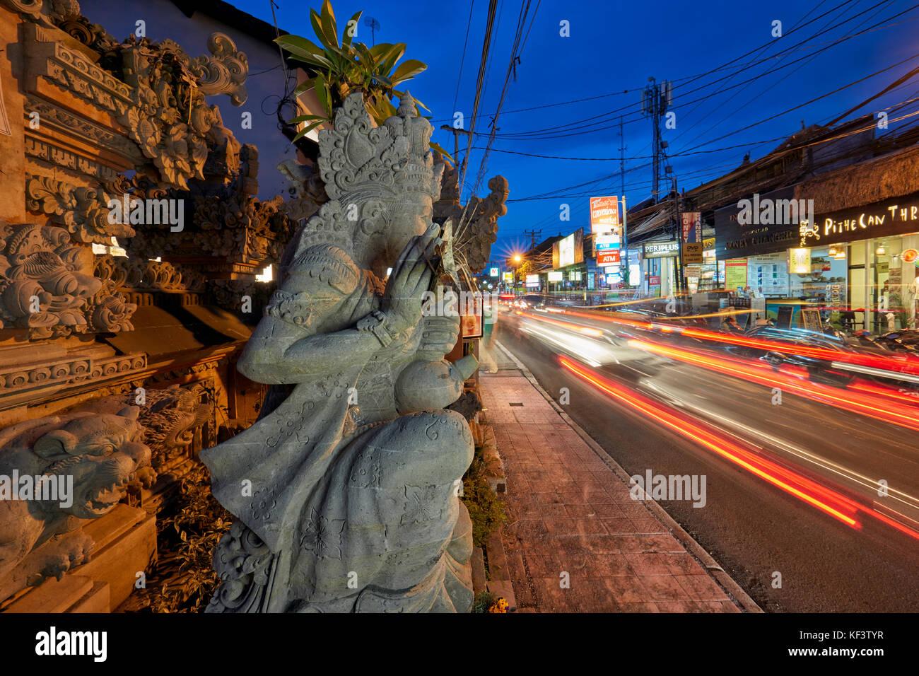 Jalan Raya Street illuminated at dusk. Ubud, Bali, Indonesia. - Stock Image