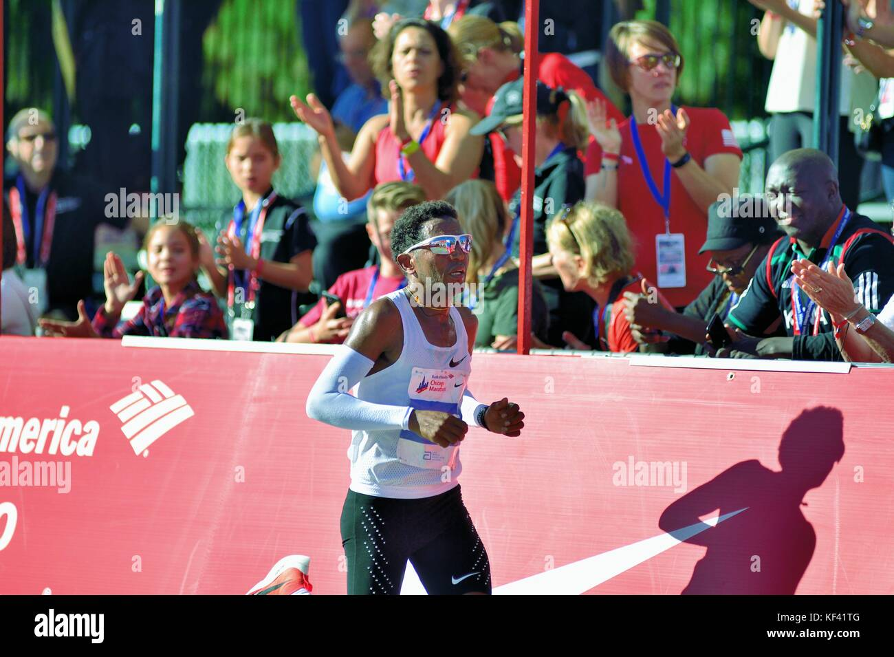 With the finish line reflecting off his sunglasses, elite runner Zersenay Tadese of Eritrea, in the home stretch - Stock Image