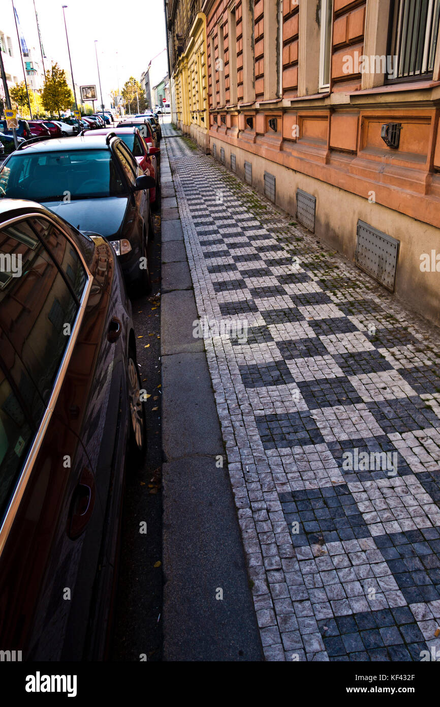 sidewalk and cars parked along it, in Prague - Stock Image
