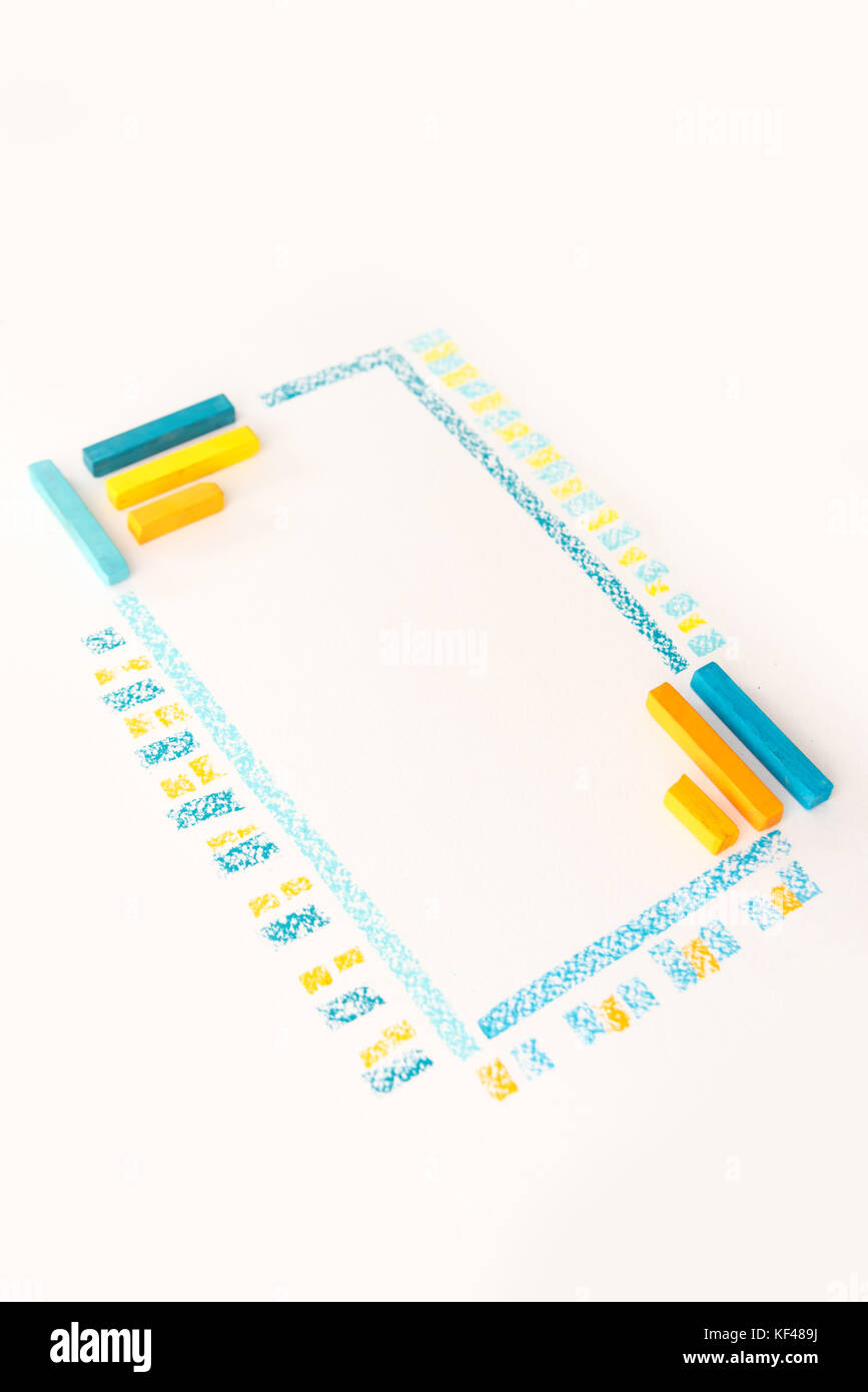 Photo of color chalk drawing as striped line on white paper background - Stock Image