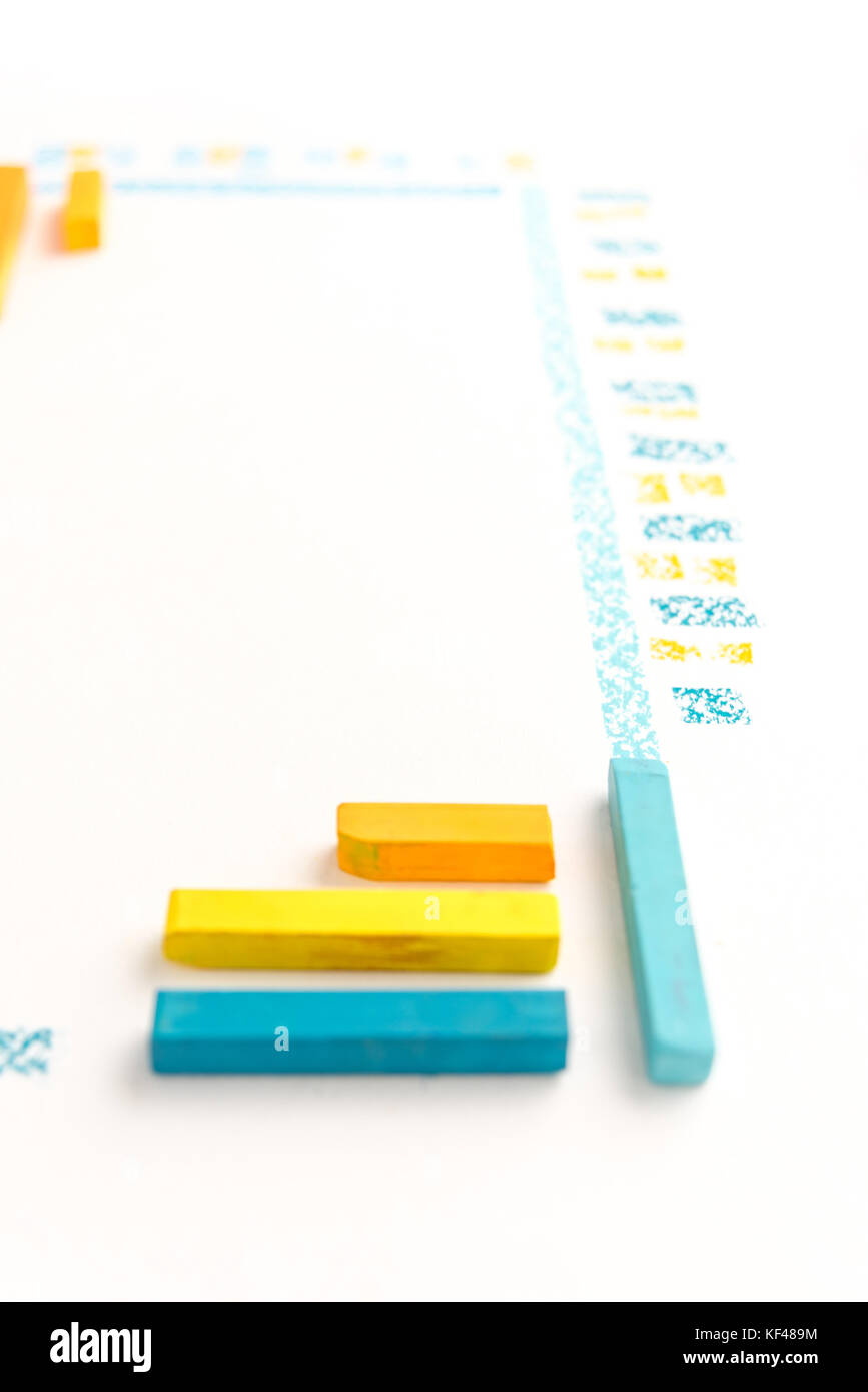 Cropped photo of color chalk drawing as striped line on white paper background - Stock Image