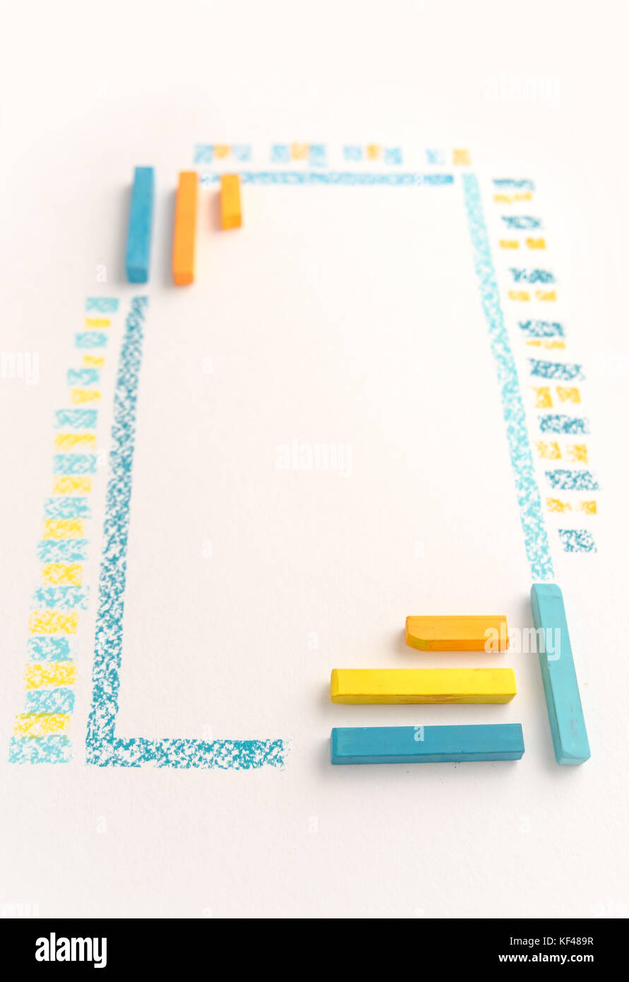 Close up photo of color chalk drawing as striped line on white paper background - Stock Image