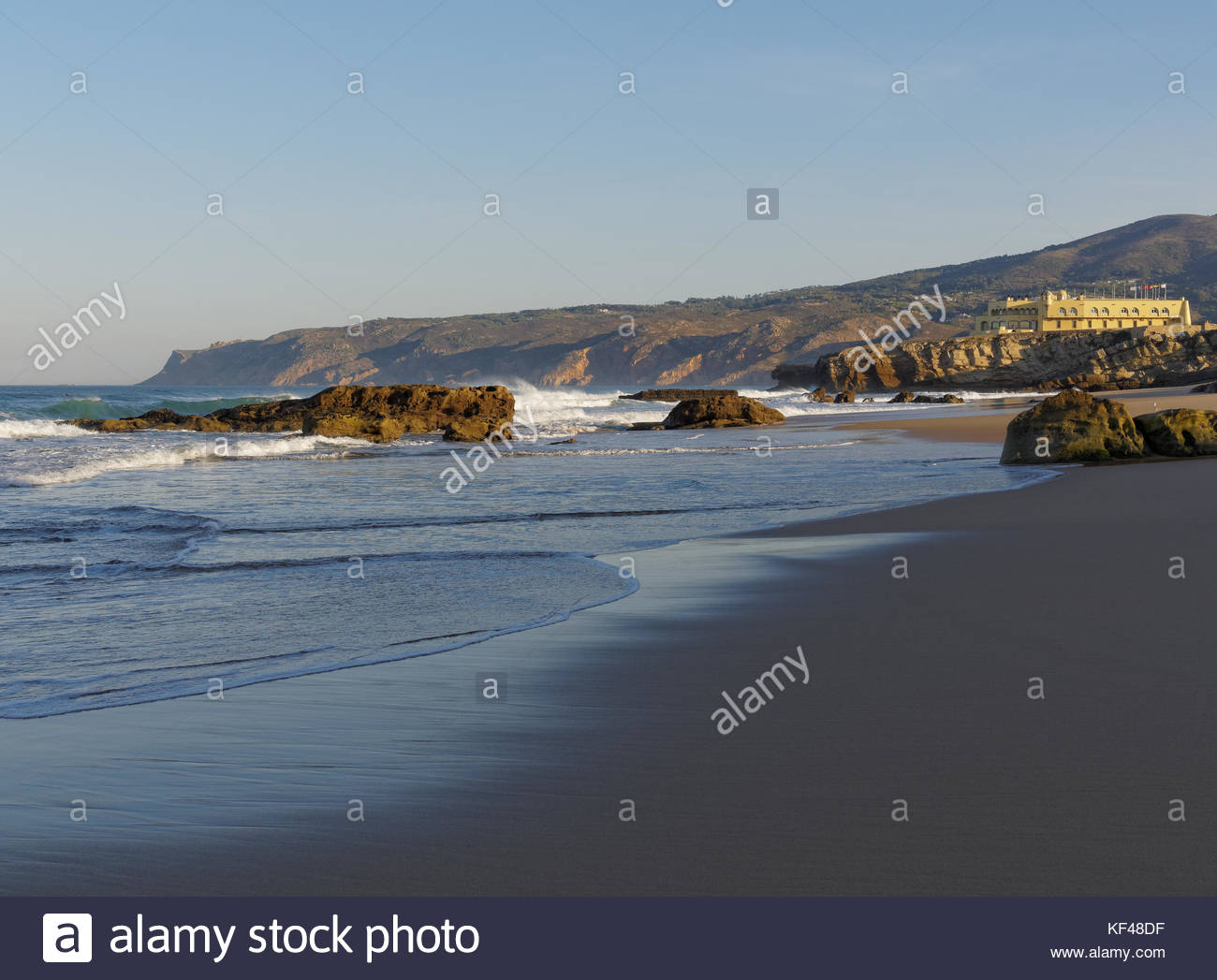 View of Hotel Fortaleza do Guincho from rocky beach, sunrise, Portugal - Stock Image
