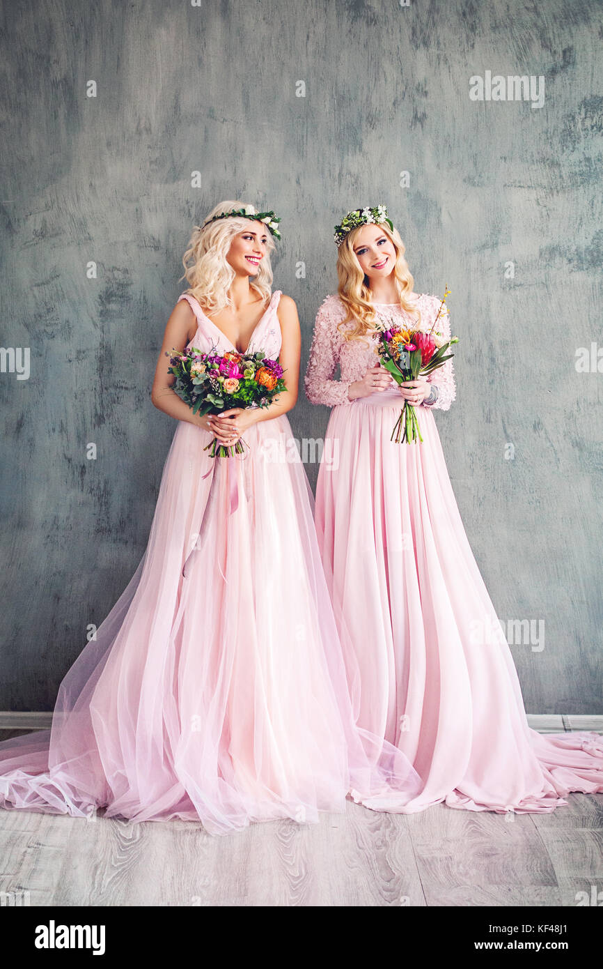 Blonde Beauty Perfect Fashion Model Women In Pink Dress On Grey