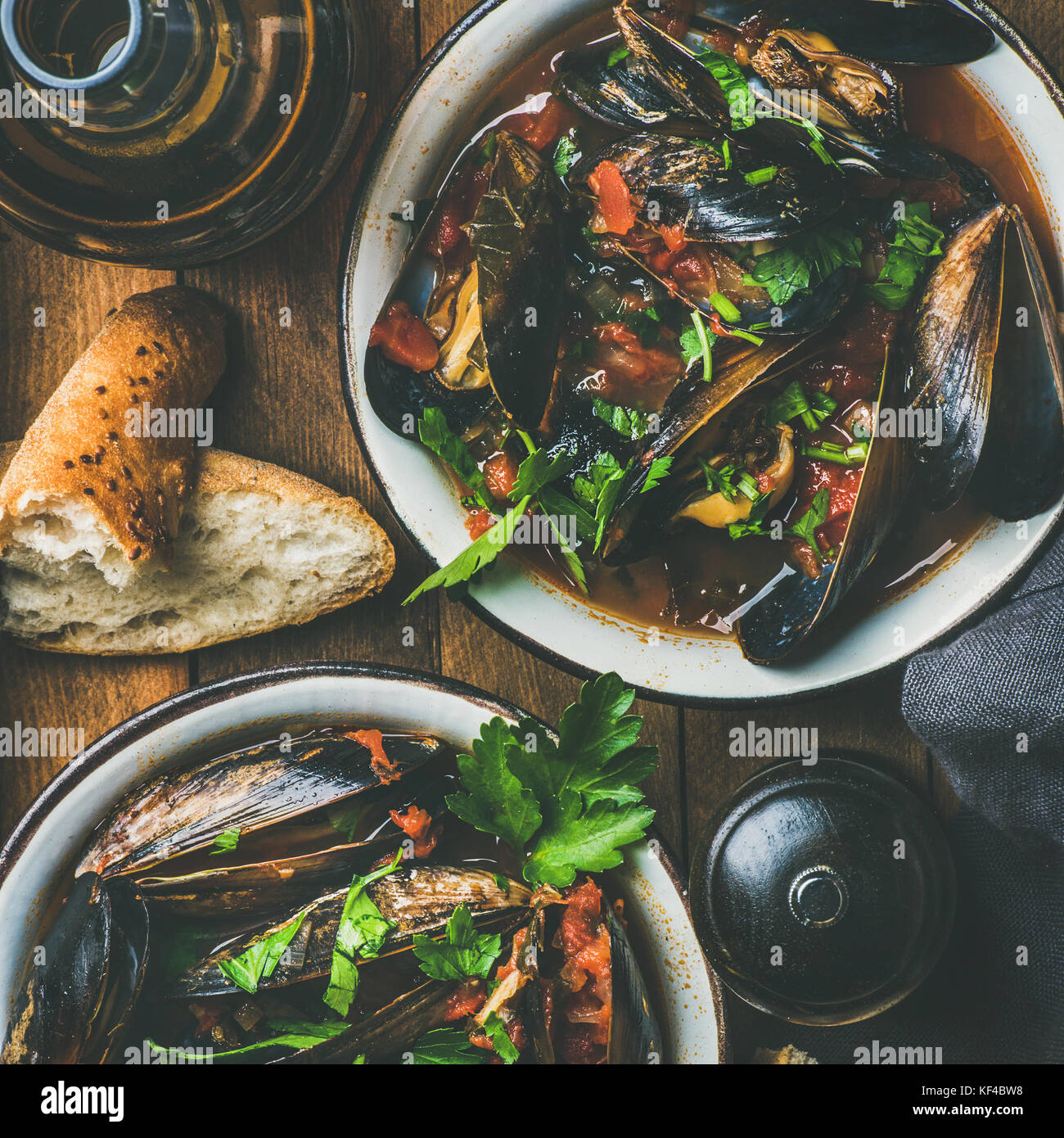 Belgian boiled mussels in tomato sauce with parsley, square crop - Stock Image