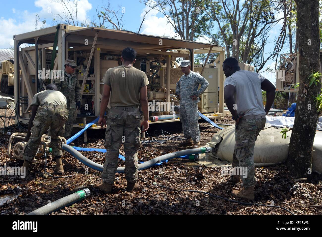 U.S. Army soldiers bring in purified water after a water treatment facility was damaged by Hurricane Maria October - Stock Image