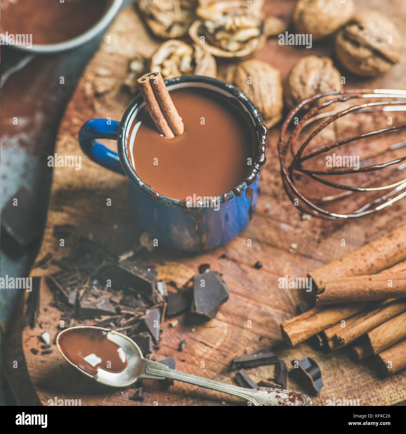 Making rich hot chocolate with cinnamon and walnuts, square crop - Stock Image