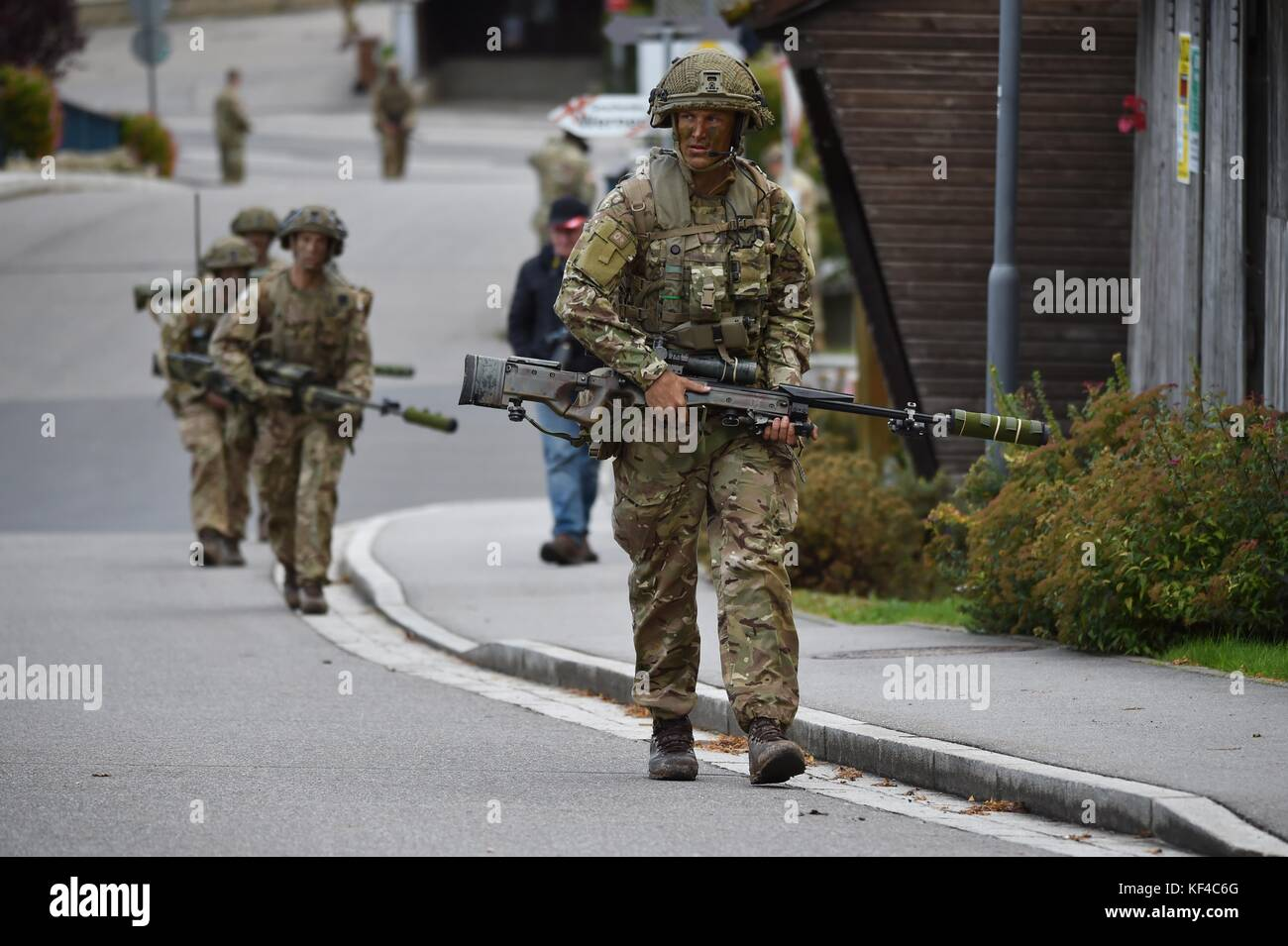 British soldiers walk through a village during Exercise Swift Response near the Joint Multinational Readiness Center - Stock Image