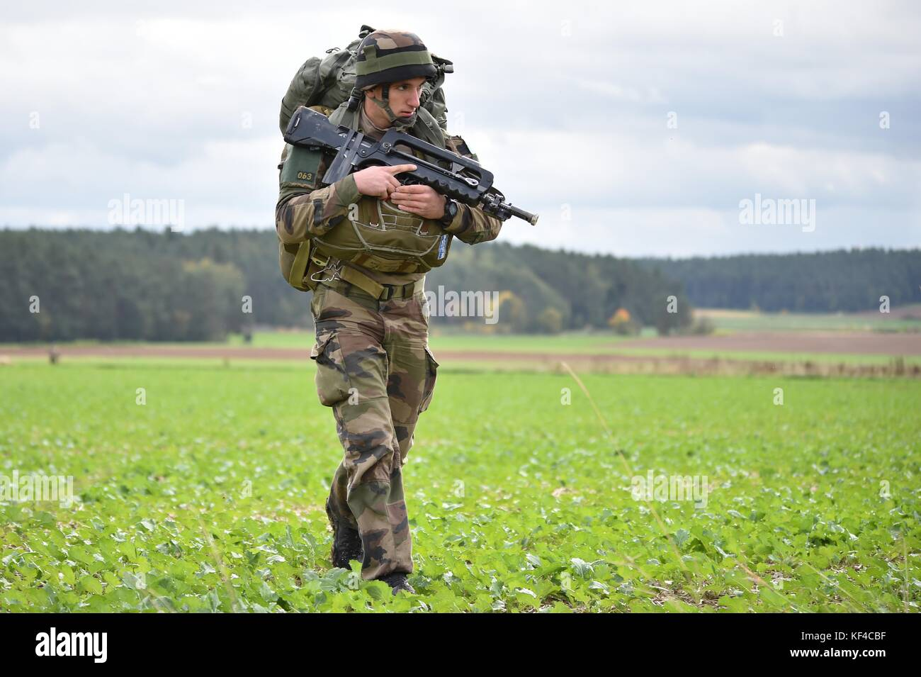 A French soldier walks off the drop zone after an airborne operation during Exercise Swift Response near the Joint - Stock Image