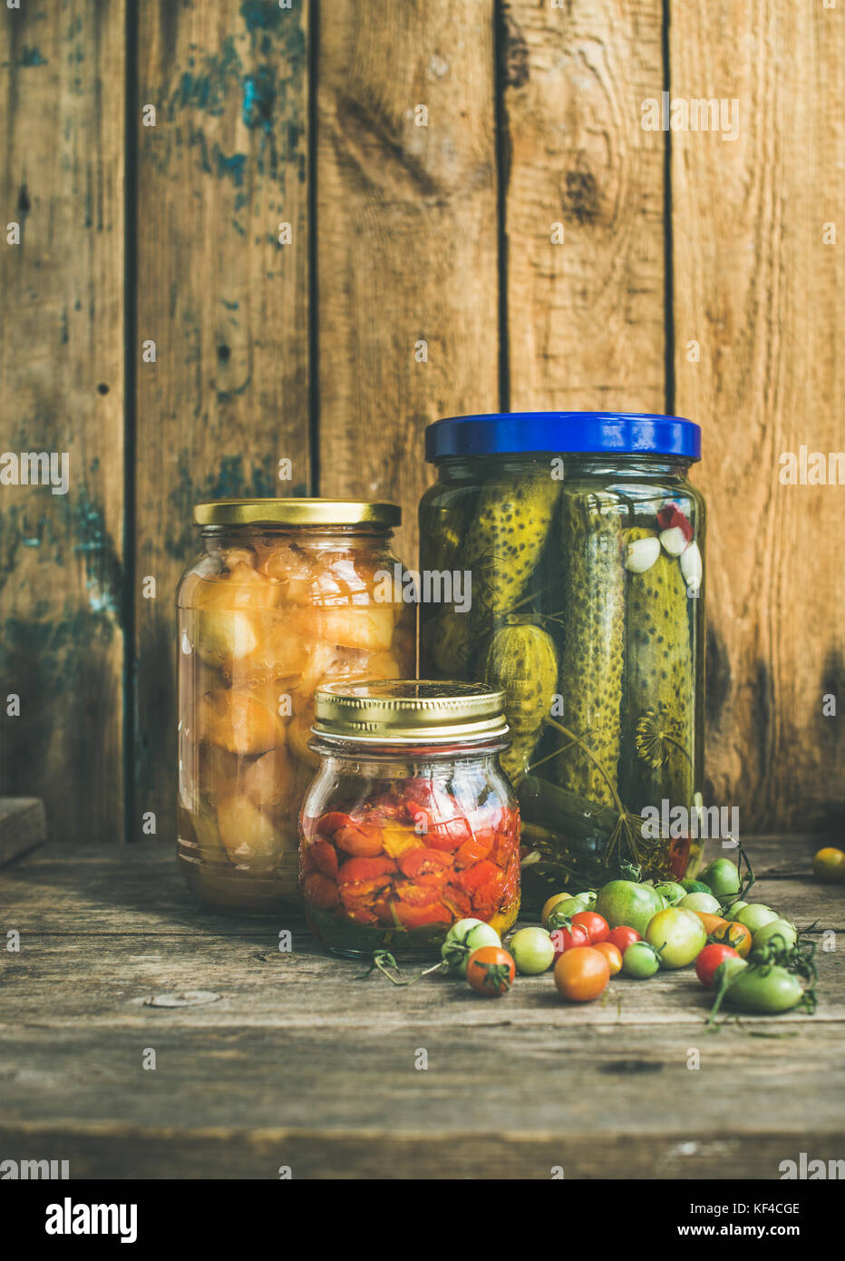 Autumn seasonal pickled vegetables and fruit in jars, copy space - Stock Image
