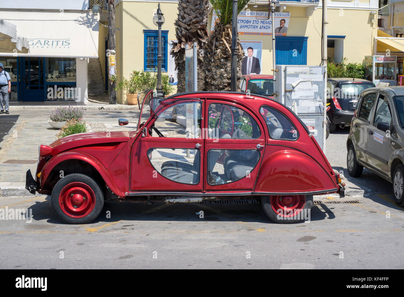 Citroen 2CV, french car at the harbour of Naxos-town, Naxos, Cyclades, Aegean, Greece - Stock Image