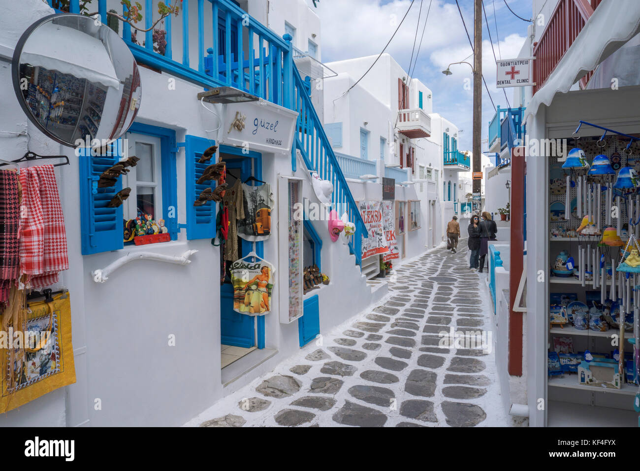 Souvenir shops at a narrow alley, Mykonos-town, Mykonos, Cyclades, Aegean, Greece - Stock Image