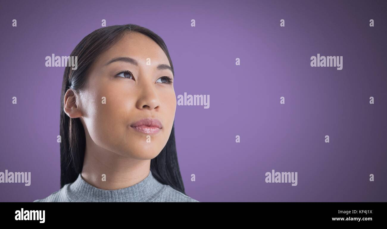 Digital composite of Woman looking up with purple background - Stock Image