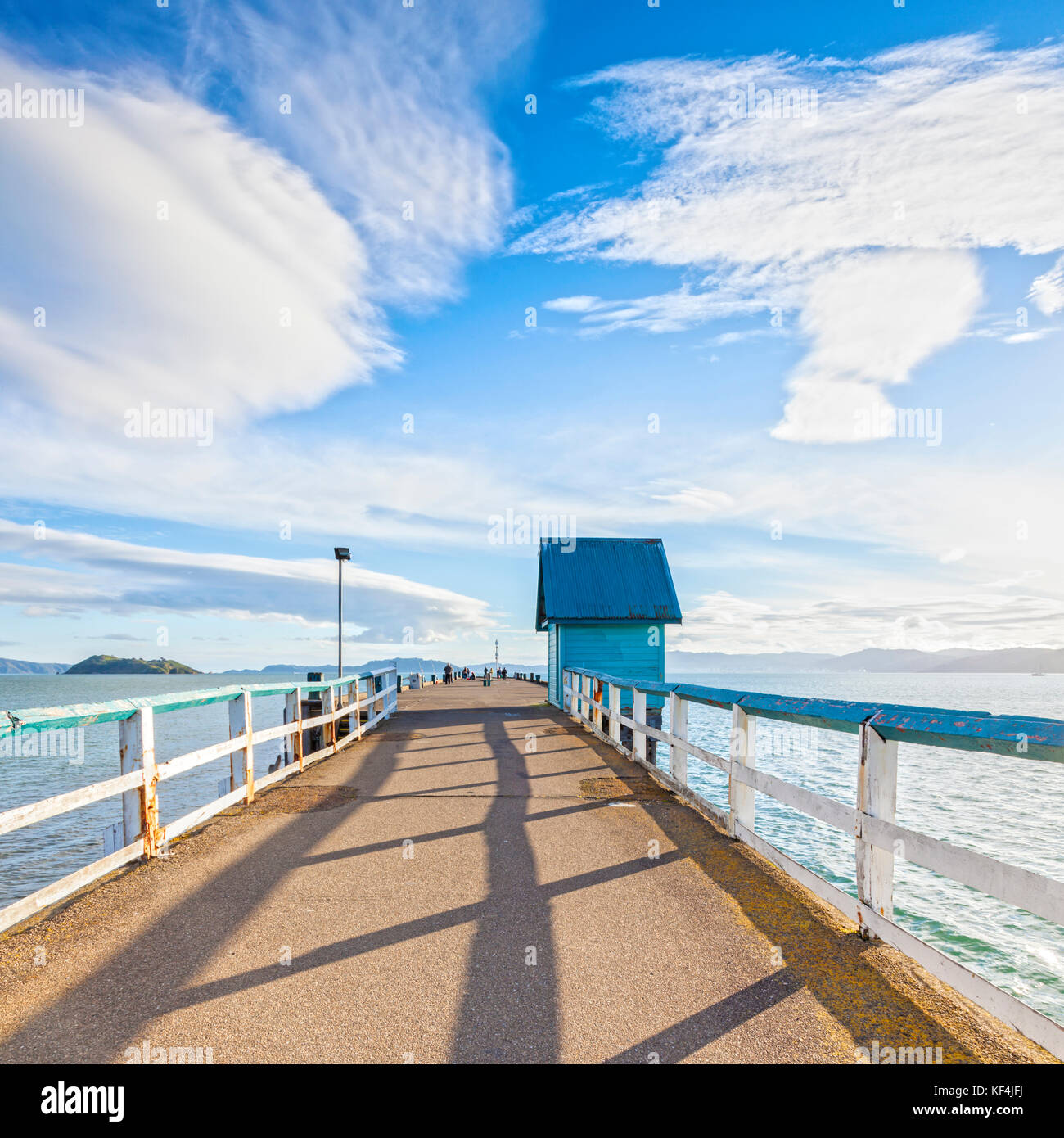 Old jetty at Petone, Wellington,New Zealand under a dramatic sunny sky. - Stock Image