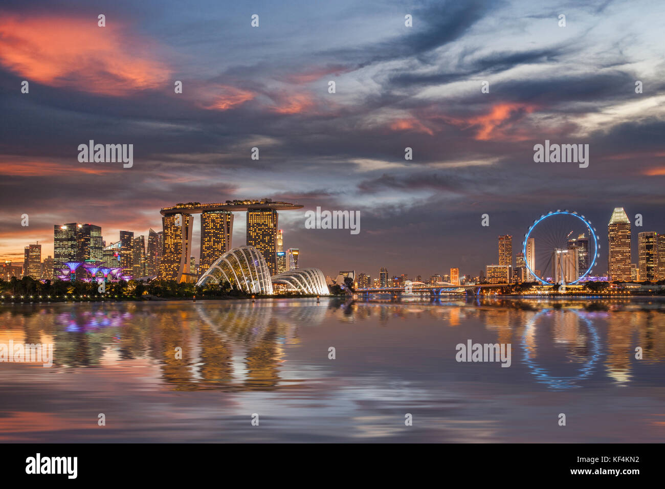 Singapore skyline reflected in Marina Bay, with Supertrees, the Cloud and Flower Domes, Marina Bay Sands, the Singapore - Stock Image