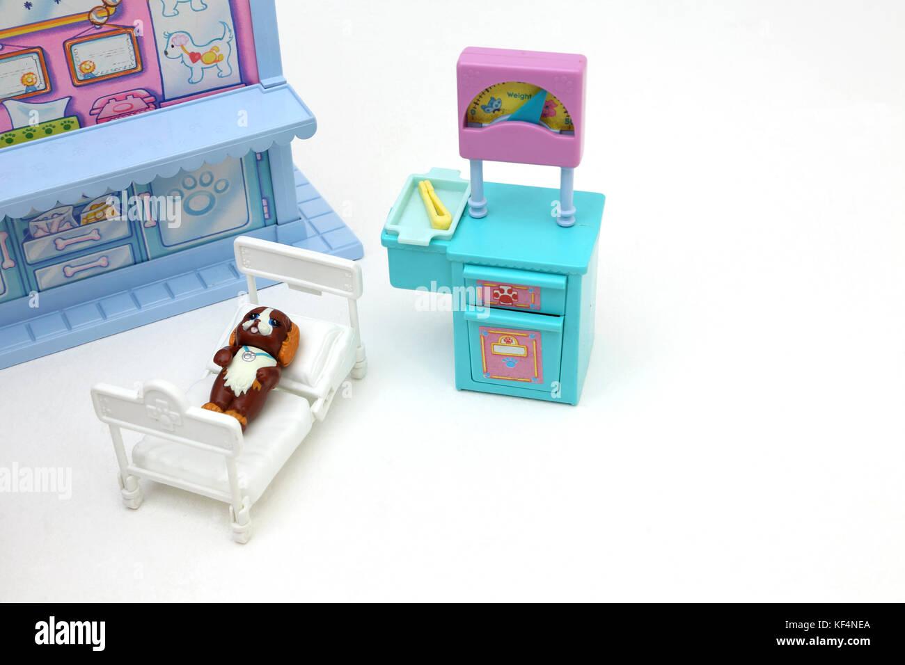 Vintage 1990's Toy Littlest Pet Shop Care Centre Dog in bed - Stock Image