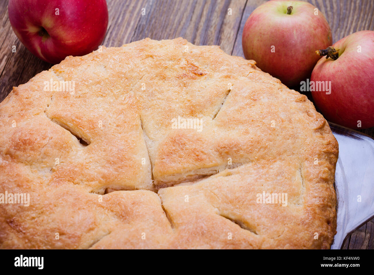 Homemade traditional autumn apple pie  with a flaky pie crust  on rustic wooden table - Stock Image