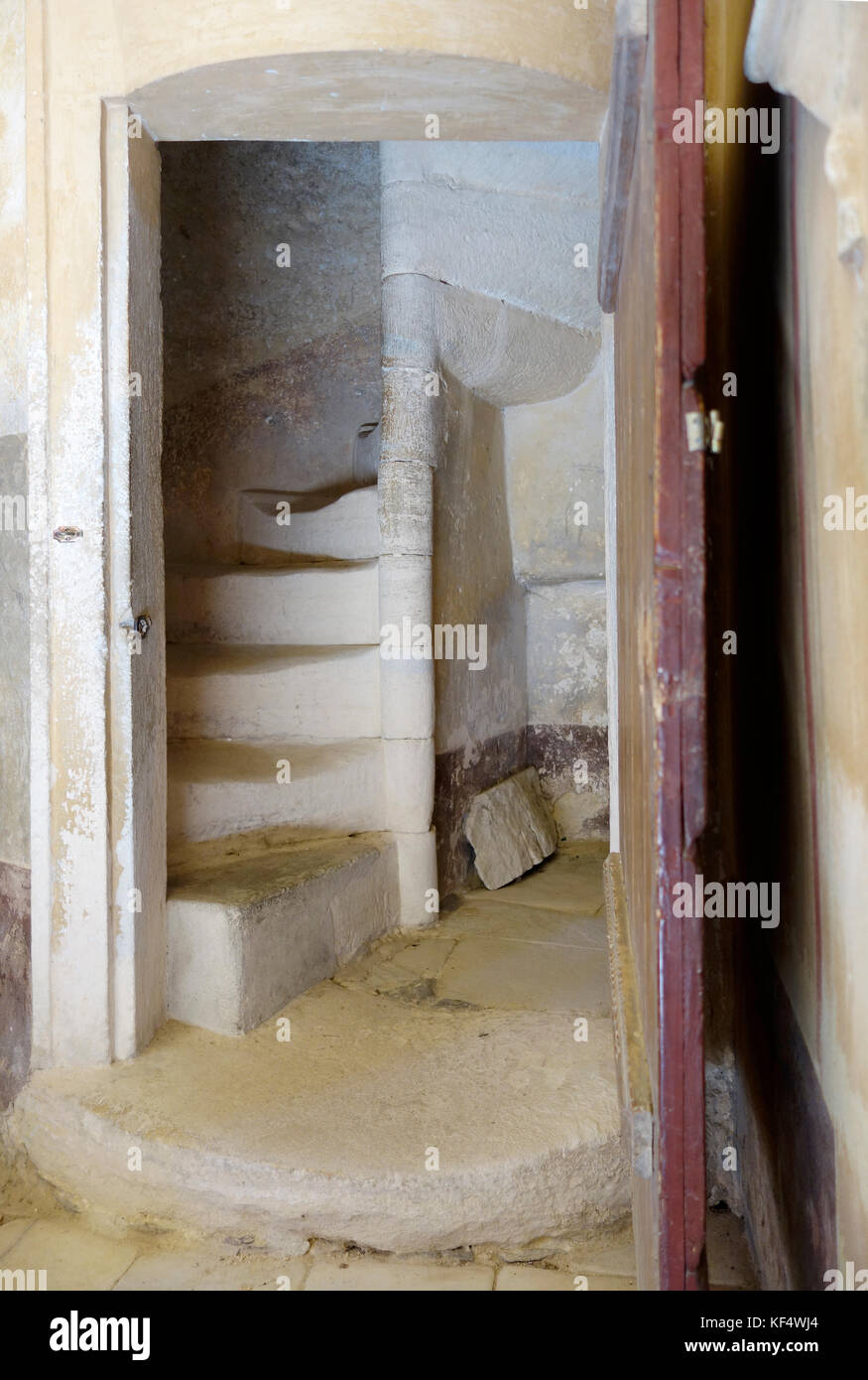 Entrance door and old worn out fly of spiral stone staircases - Stock Image
