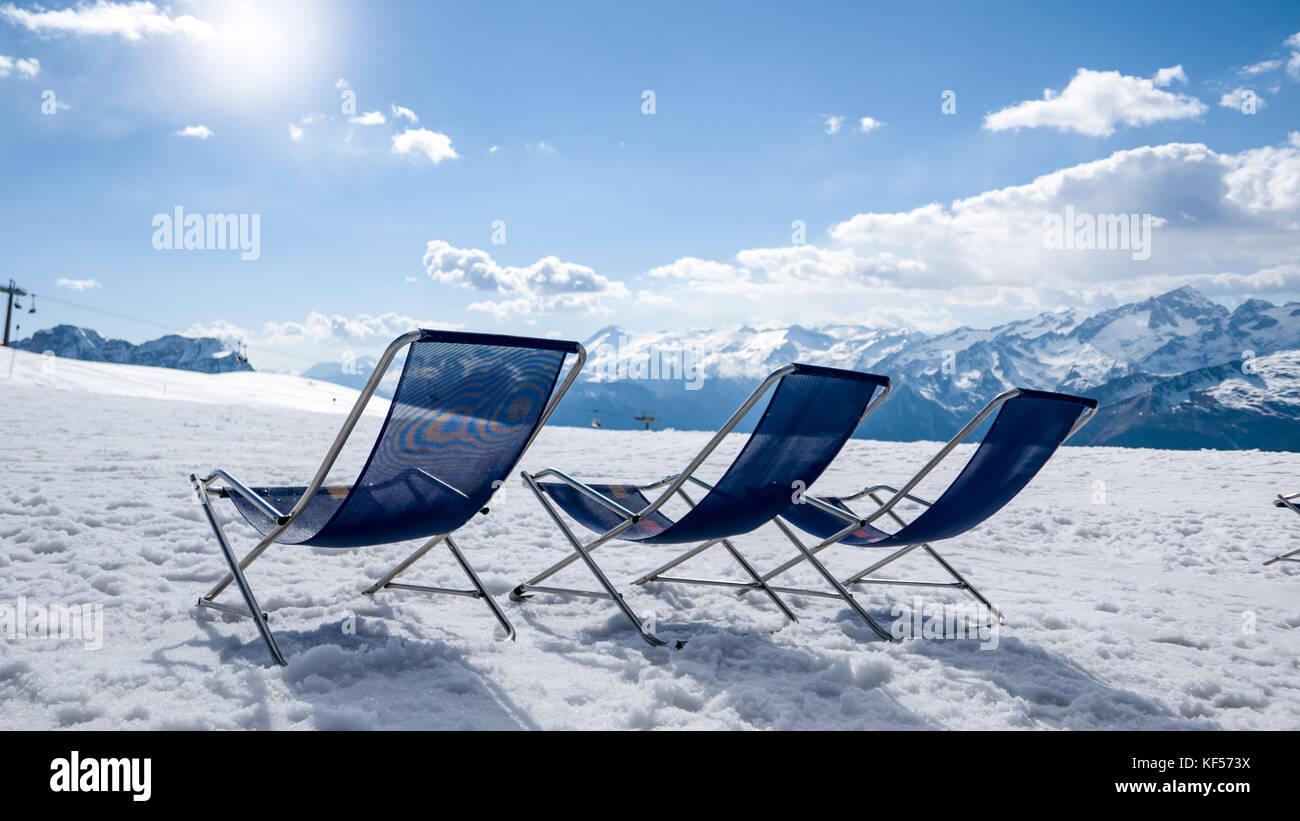 Snow and sun in the mountain ski resort - Stock Image